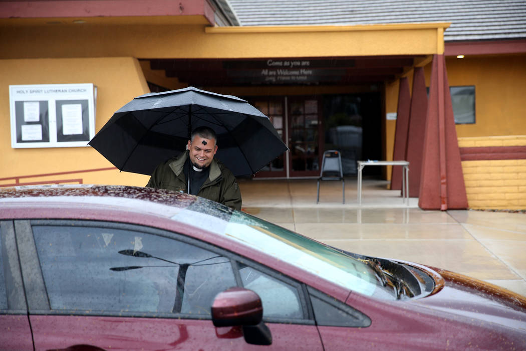 "Pastor Jeremy Nausin talks to a driver at Holy Spirit Lutheran Church during an ""Ashes to Go"" drive-thru Ash Wednesday blessing at the Las Vegas church, Wednesday, March 6, 2019. (K.M. Cannon/Las ..."