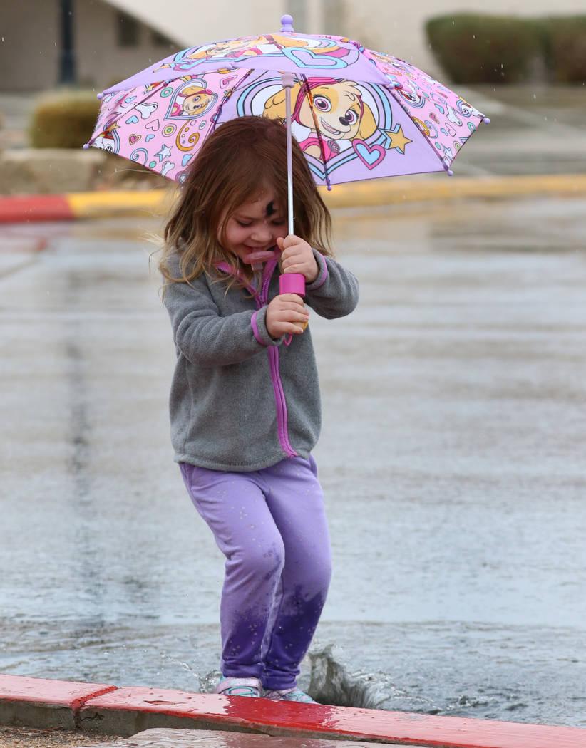 Kaisyn Wood, 3, of Las Vegas plays in puddle during the rain on Wednesday, March. 6, 2019, in Las Vegas. (Bizuayehu Tesfaye/Las Vegas Review-Journal) @bizutesfaye