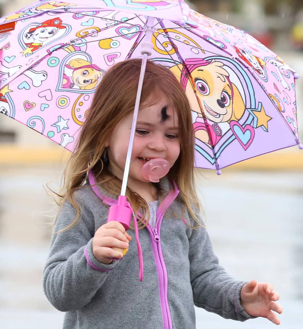 Kaisyn Wood, 3, of Las Vegas holds an umbrella to protect herself from rain on Wednesday, March. 6, 2019, in Las Vegas. (Bizuayehu Tesfaye/Las Vegas Review-Journal) @bizutesfaye