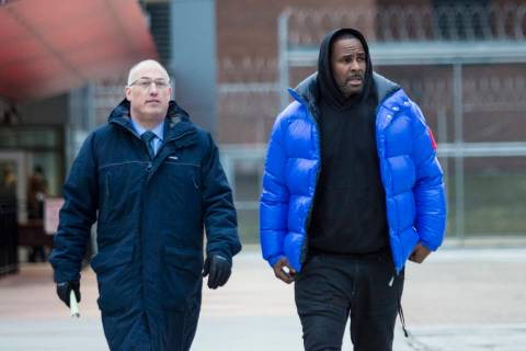 FR. Kelly, right, walks out of Cook County Jail with his defense attorney, Steve Greenberg after posting $100,000 bail in Chicago, Feb. 25, 2019. In his first interview since being charged with se ...