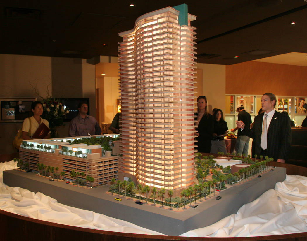 In this photo provided by Pinnacle Las Vegas, Kyle Waugh, right, owner of Rise Realty, announces the unveiling of the Pinnacle Las Vegas high-rise project on Thursday, June 22, 2006. (AP Photo/Pin ...