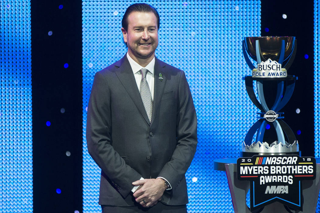 Kurt Busch takes photos after receiving the Pole Award at the NASCAR NMPA Myers Brothers Awards at Encore Theater on Wednesday, Nov. 28, 2018, at Wynn Las Vegas, in Las Vegas. Benjamin Hager Las V ...