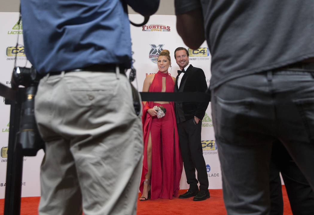 NASCAR driver Kurt Busch, right, with wife Ashley Van Metre during the red carpet event before the start of the 2018 MMA Awards on Tuesday, July 3, 2018, at the Palms hotel-casino, in Las Vegas. B ...