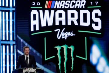 Dale Earnhardt Jr. speaks during the NASCAR Cup Series auto racing awards Thursday, Nov. 30, 2017, in Las Vegas. (AP Photo/Isaac Brekken)