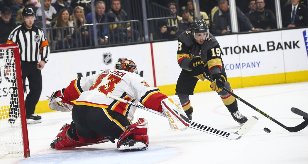 Calgary Flames goaltender David Rittich (33) blocks the puck in front of Golden Knights right wing Reilly Smith (19) during the first period of an NHL hockey game at T-Mobile Arena in Las Vegas on ...
