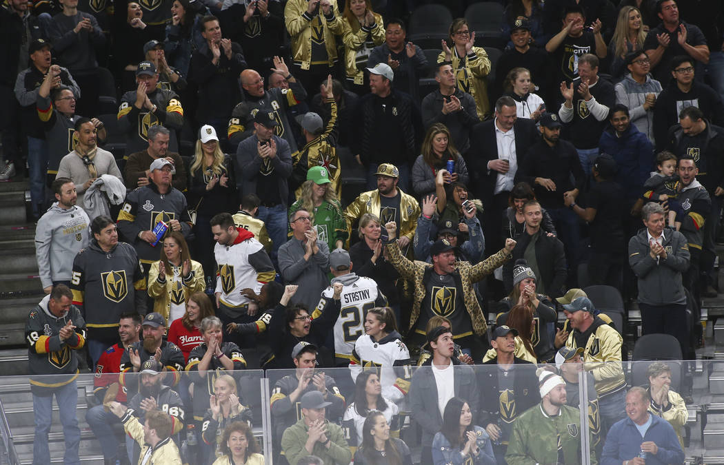 Golden Knights fans celebrate a goal by Golden Knights defenseman Deryk Engelland, not pictured, during the third period of an NHL hockey game against the Calgary Flames at T-Mobile Arena in Las V ...