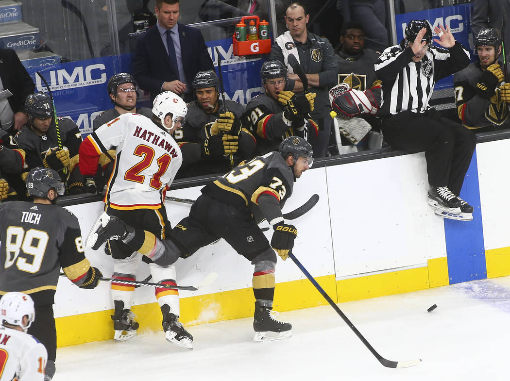 Golden Knights center Brandon Pirri (73) chases after the puck past Calgary Flames right wing Garnet Hathaway (21) during the third period of an NHL hockey game at T-Mobile Arena in Las Vegas on W ...