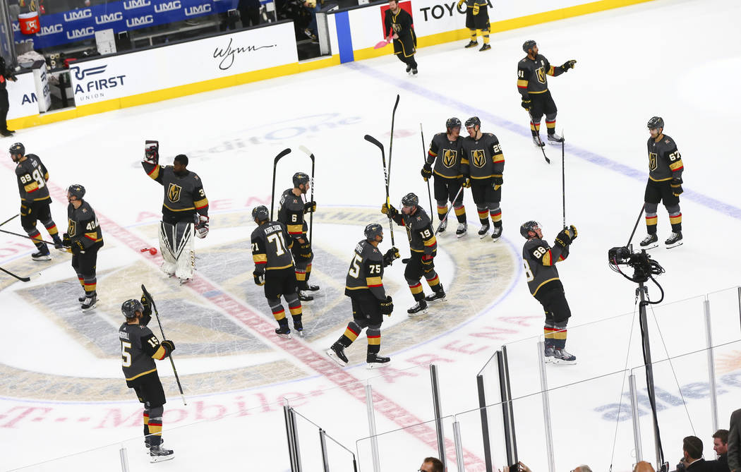 Golden Knights players celebrate their win over the Calgary Flames in an NHL hockey game at T-Mobile Arena in Las Vegas on Wednesday, March 6, 2019. (Chase Stevens/Las Vegas Review-Journal) @csste ...
