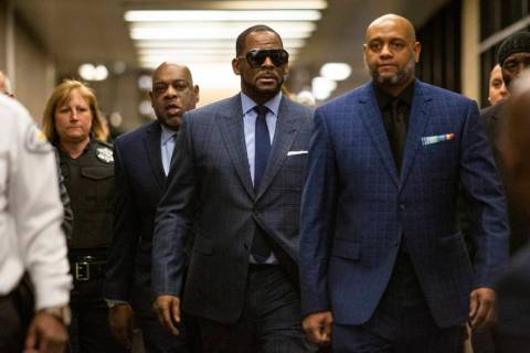 Musician R. Kelly arrives at the Daley Center for a hearing in his child support case at the Daley Center, Wednesday, March 6, 2019, in Chicago. Kelly was charged last month with sexually abusing ...