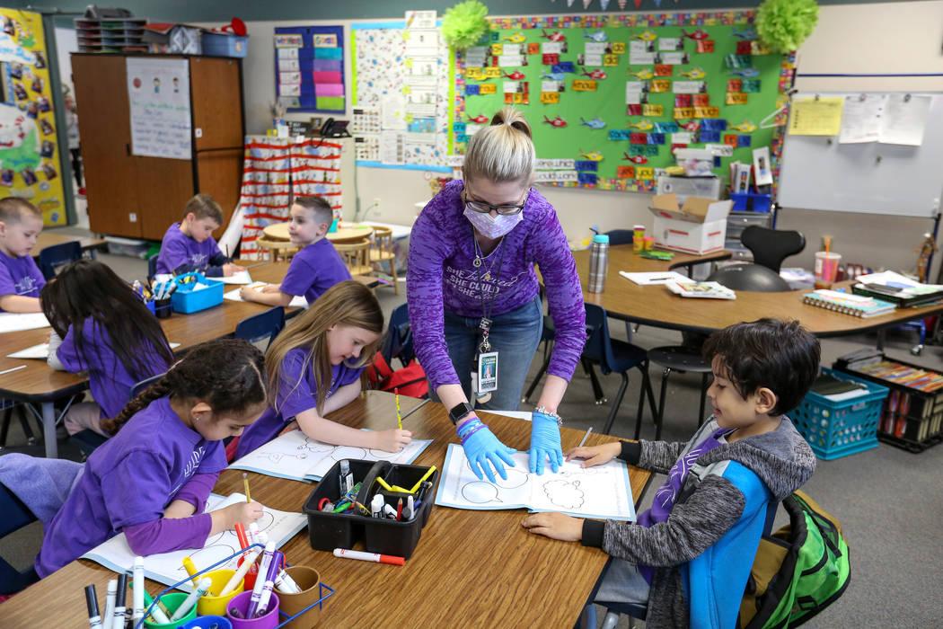 "Nikki McGuire teaches her kindergarten students during a class at Staton Elementary in Las Vegas, Tuesday, March 5, 2019. Every Tuesday the school wears ""Hope for Nikki"" shirts to show t ..."