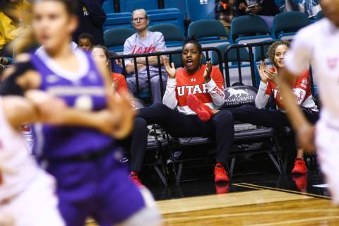 Former Liberty basketball player Dre'Una Edwards, who now plays for Utah, cheers her team on as they play Washington during the Pac-12 women's basketball tournament at the MGM Grand Garden Arena i ...