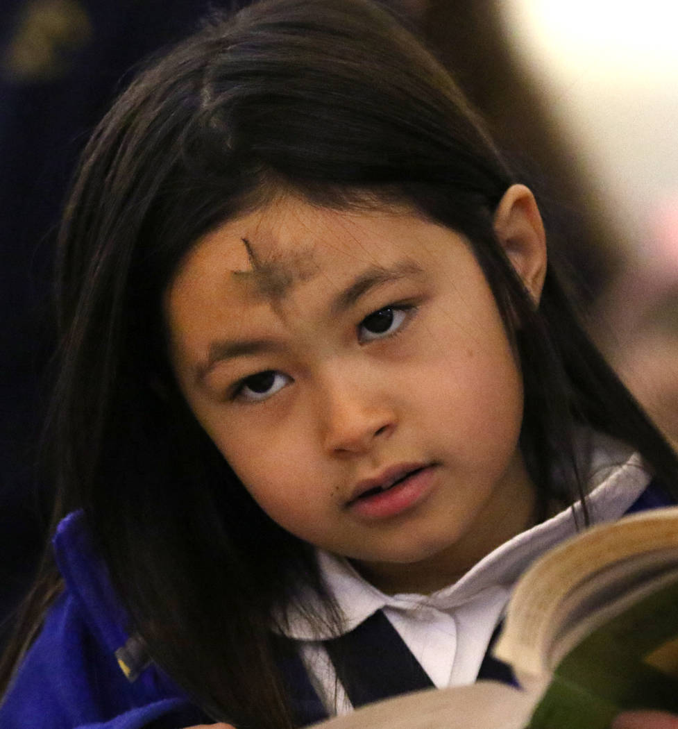 St. Viator Parish School student Delilah DeMarco, 7, celebrates Ash Wednesday at St. Viator Catholic Church on Wednesday, March. 6, 2019, in Las Vegas. Bizuayehu Tesfaye Las Vegas Review-Journal @ ...