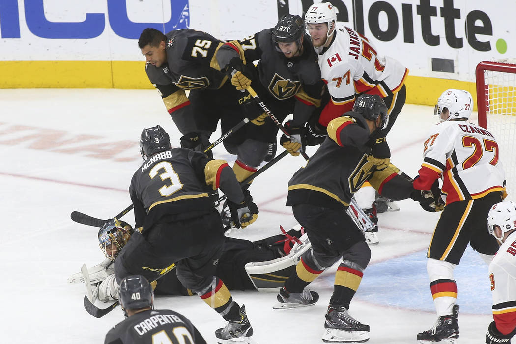 Golden Knights goaltender Marc-Andre Fleury dives to stop the puck during the third period of an NHL hockey game against the Calgary Flames at T-Mobile Arena in Las Vegas on Wednesday, March 6, 20 ...