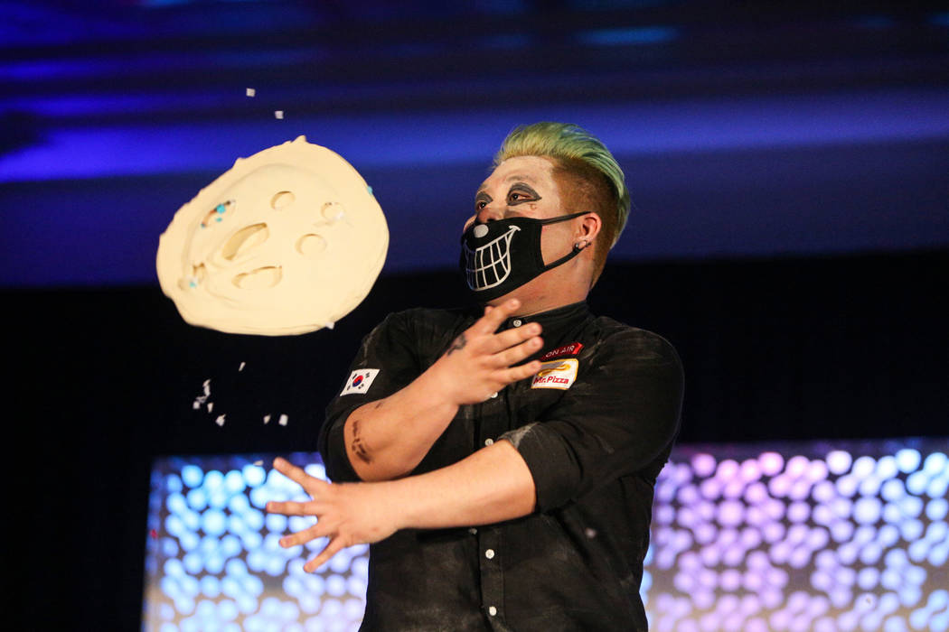 Juntae Jin competes in the dough-tossing championship of the International Pizza Expo at the Las Vegas Convention Center in Las Vegas, Wednesday, March 6, 2019. (Caroline Brehman/Las Vegas Review- ...