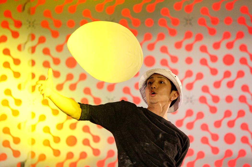Takumi Tachikawa from Japan competes in the dough-tossing championship of the International Pizza Expo at the Las Vegas Convention Center in Las Vegas, Wednesday, March 6, 2019. (Caroline Brehman/ ...