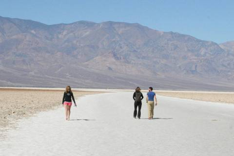 Visitors walk the salt flats at Badwater Basin in Death Valley National Park in California. (Las Vegas Review-Journal)