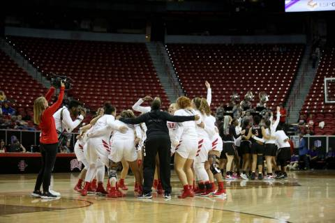Fresno State Bulldogs, left, and UNLV Lady Rebels prepare for their quarterfinal game of the Mountain West women's basketball tournament at the Thomas & Mack Center in Las Vegas Monday, March ...