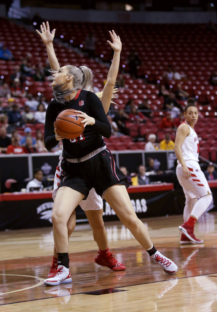 UNLV Lady Rebels forward Katie Powell (21) looks to shoot against Fresno State in the first quarter of their quarterfinal game of the Mountain West women's basketball tournament at the Thomas &amp ...