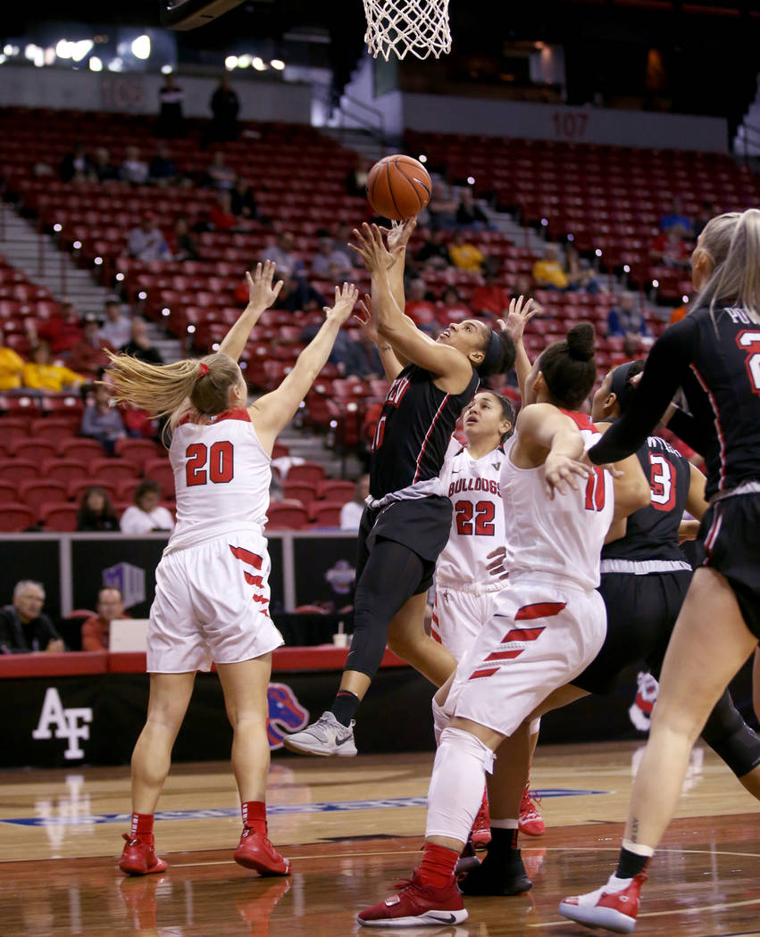 UNLV Lady Rebels guard Nikki Wheatley (10) shoots over Fresno State Bulldogs guard Bree Delaney (20) in the first quarter of their quarterfinal game of the Mountain West women's basketball tournam ...