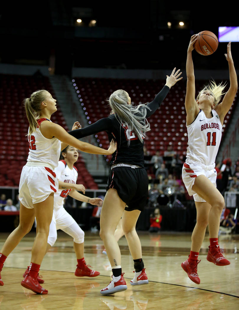 Fresno State Bulldogs forward Maddi Utti (11) intercepts a pass for UNLV Lady Rebels forward Katie Powell (21) in the first quarter of their quarterfinal game of the Mountain West women's basketba ...