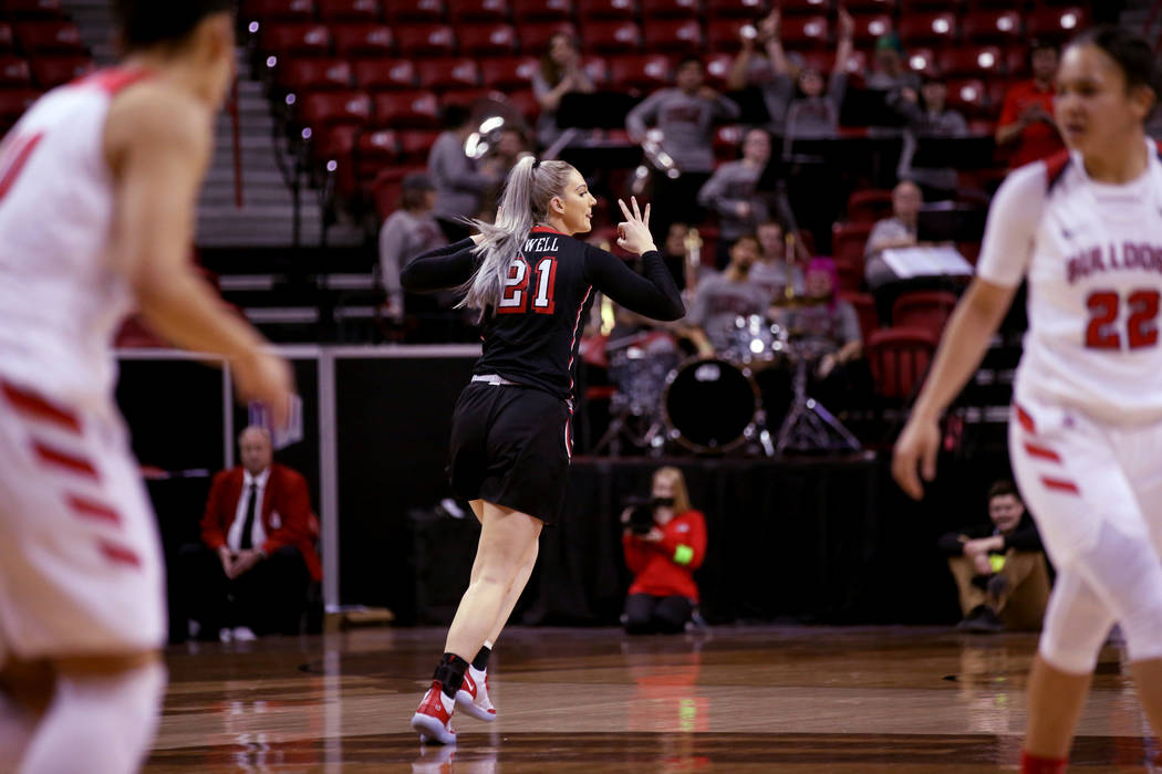 UNLV Lady Rebels forward Katie Powell (21) reacts to a three-point basket against Fresno State in the first quarter of their quarterfinal game of the Mountain West women's basketball tournament at ...