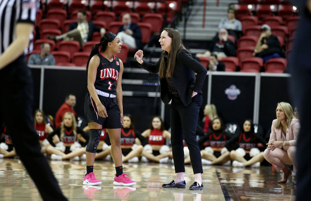 UNLV Lady Rebels head coach Kathy Olivier talks to guard Kavionnia Brown (1) in the first quarter of a quarterfinal game against Fresno State in the Mountain West women's basketball tournament at ...