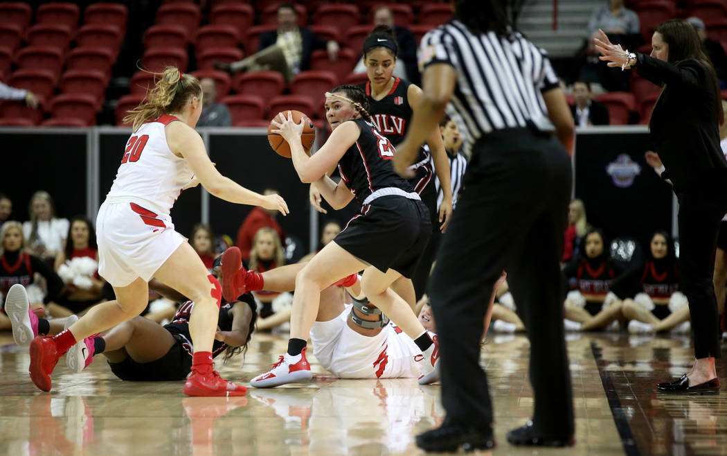 UNLV Lady Rebels forward Alyssa Anderson (20) grabs a loose ball in the first quarter of a quarterfinal game against Fresno State in the Mountain West women's basketball tournament at the Thomas & ...