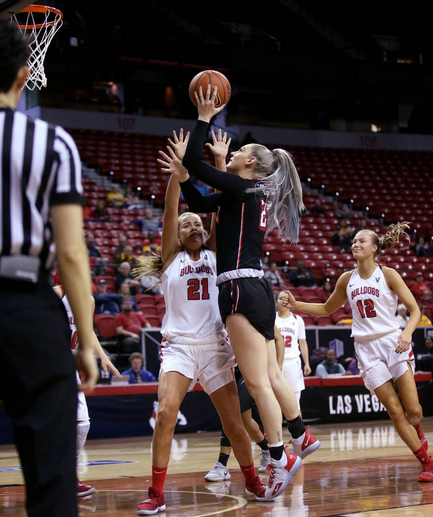 UNLV Lady Rebels forward Katie Powell (21) shoots over Fresno State Bulldogs forward Lydia Friberg (21) in the second quarter of their quarterfinal game in the Mountain West women's basketball tou ...