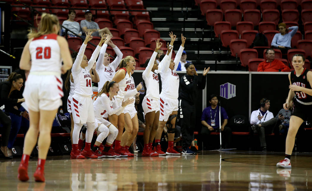 Fresno State players cheer a three-point basket against UNLV in the third quarter of their quarterfinal game in the Mountain West women's basketball tournament at the Thomas & Mack Center in L ...