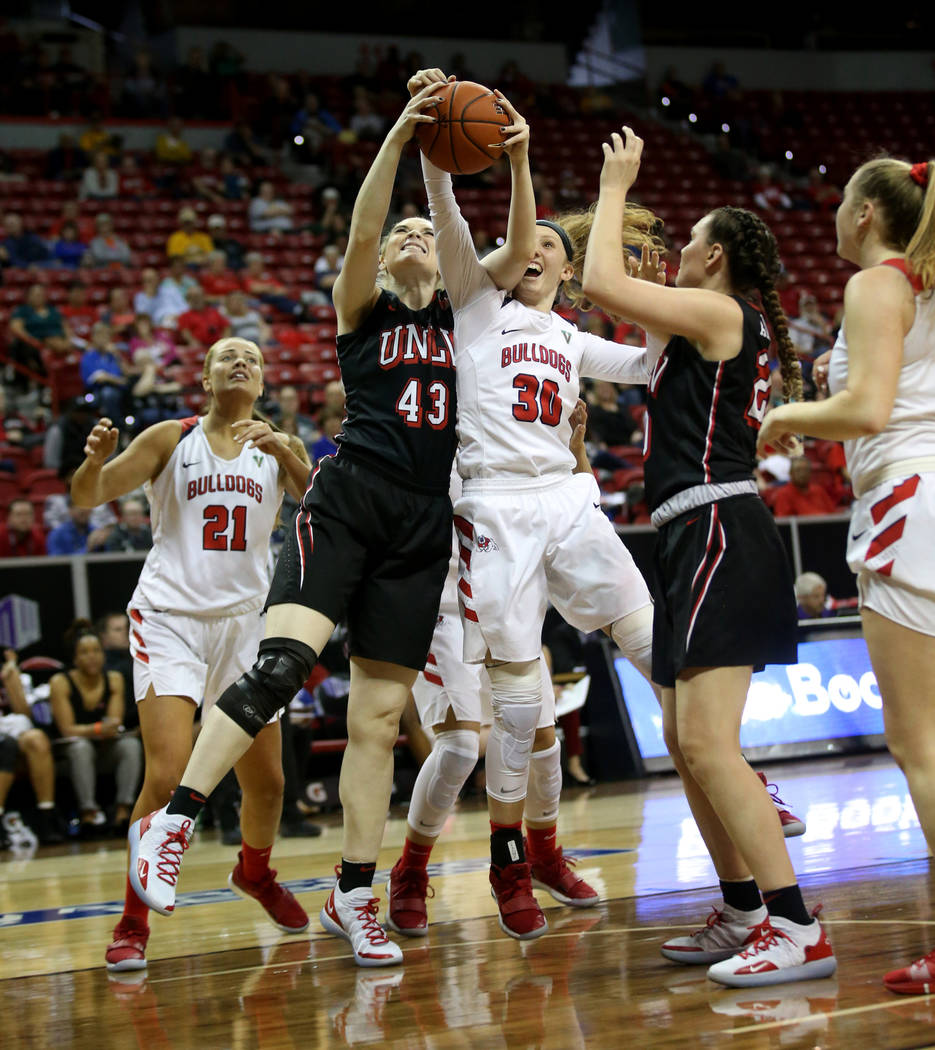 UNLV Lady Rebels center Haley Bodnar Rydalch (43) and Fresno State Bulldogs forward Kristina Cavey (30) battle for a rebound in the third quarter of their quarterfinal game in the Mountain West wo ...