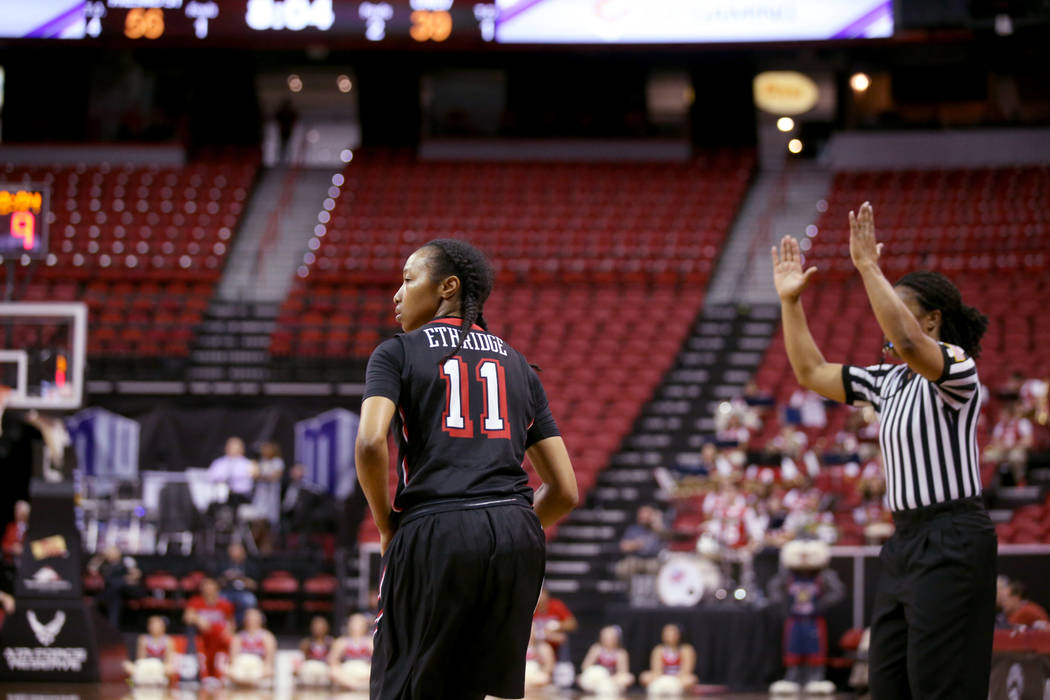 UNLV Lady Rebels guard Justice Ethridge (11) scores a three-point basket against Fresno State in the fourth quarter of their quarterfinal game in the Mountain West women's basketball tournament at ...