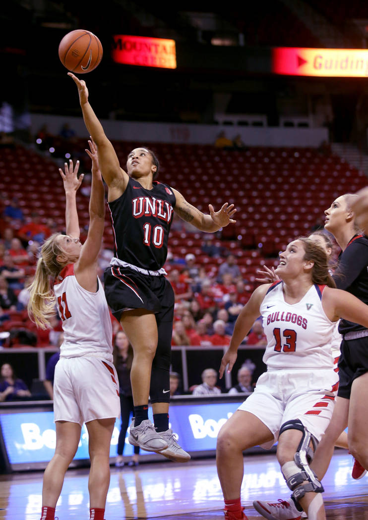 UNLV Lady Rebels guard Nikki Wheatley (10) shoots over Fresno State Bulldogs forward Maddi Utti (11) in the fourth quarter of their quarterfinal game in the Mountain West women's basketball tourna ...