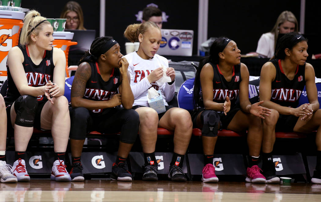 UNLV players react in the final minutes of their quarterfinal against Fresno State during their quarterfinal game in the Mountain West women's basketball tournament at the Thomas & Mack Center ...