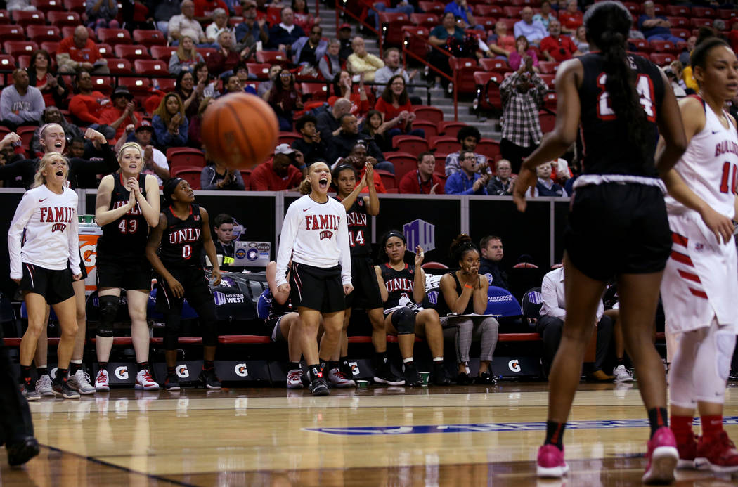 UNLV players react to a basket in the final minutes of their quarterfinal against Fresno State during their quarterfinal game in the Mountain West women's basketball tournament at the Thomas & ...