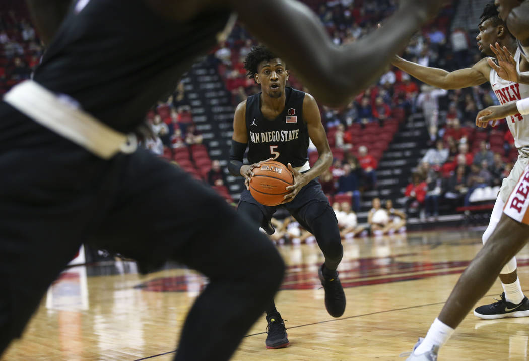 San Diego State Aztecs forward Jalen McDaniels (5) brings the ball up court against UNLV during the first half of a basketball game at the Thomas & Mack Center in Las Vegas on Saturday, Feb. 2 ...
