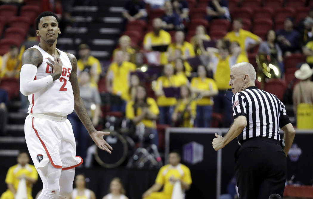 New Mexico's Corey Henson (2) reacts after sinking a 3-point shot during the second half of an NCAA college basketball game against Wyoming in the Mountain West Conference tournament, Wednesday, M ...
