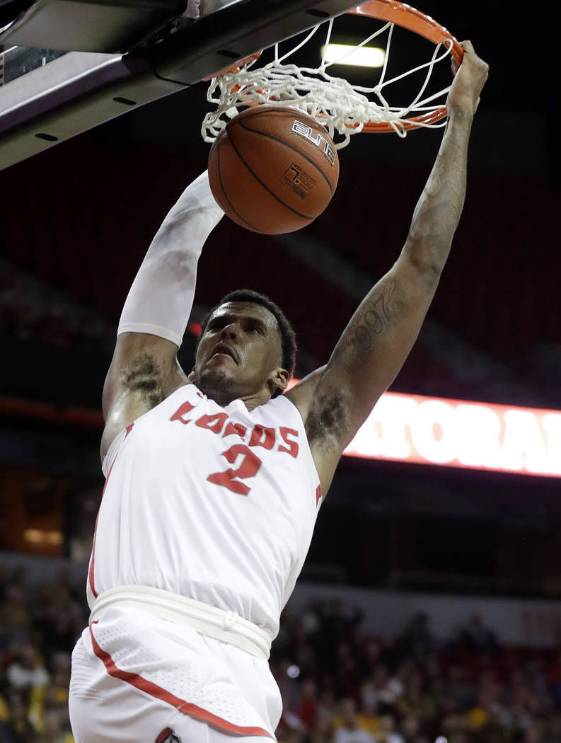 New Mexico's Corey Henson dunks during the second half of the team's NCAA college basketball game against Wyoming in the Mountain West Conference men's tournament Wednesday, March 13, 2019, in Las ...