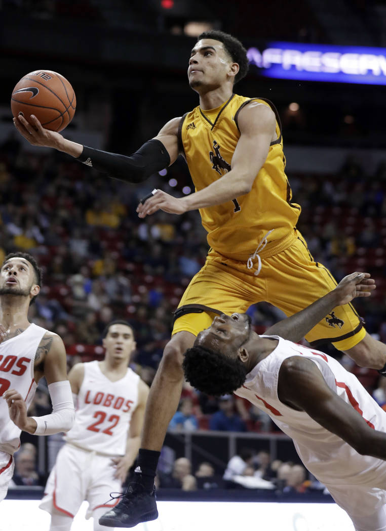 Wyoming's Justin James shoots over New Mexico's Jalen Harris during the first half of an NCAA college basketball game in the Mountain West Conference men's tournament Wednesday, March 13, 2019, in ...
