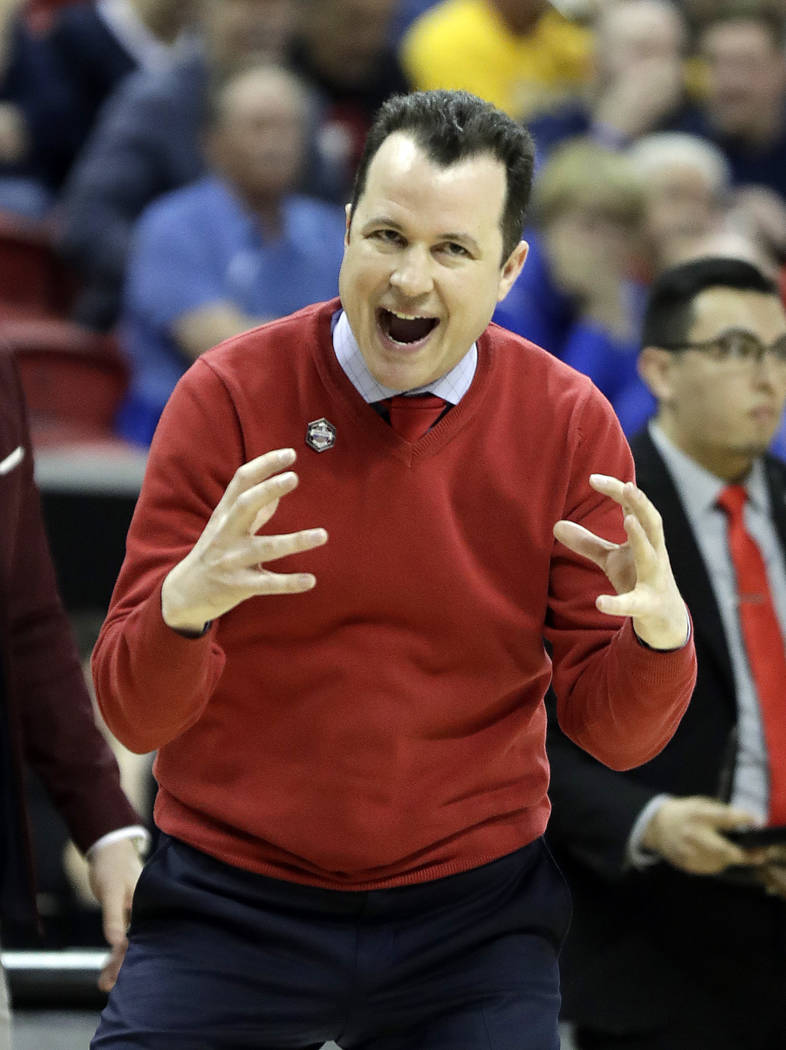 New Mexico head coach Paul Weir instructs his team during the first half of an NCAA college basketball game against Wyoming in the Mountain West Conference tournament, Wednesday, March 13, 2019, i ...