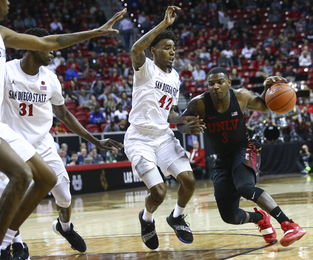 UNLV Rebels guard Amauri Hardy (3) drives against San Diego State Aztecs guard Jeremy Hemsley (42) during the first half of a quarterfinal game in the Mountain West men's basketball tournament at ...