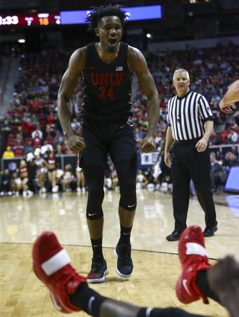 UNLV Rebels forward Joel Ntambwe (24) celebrates after a foul was called against San Diego State during the first half of a quarterfinal game in the Mountain West men's basketball tournament at th ...