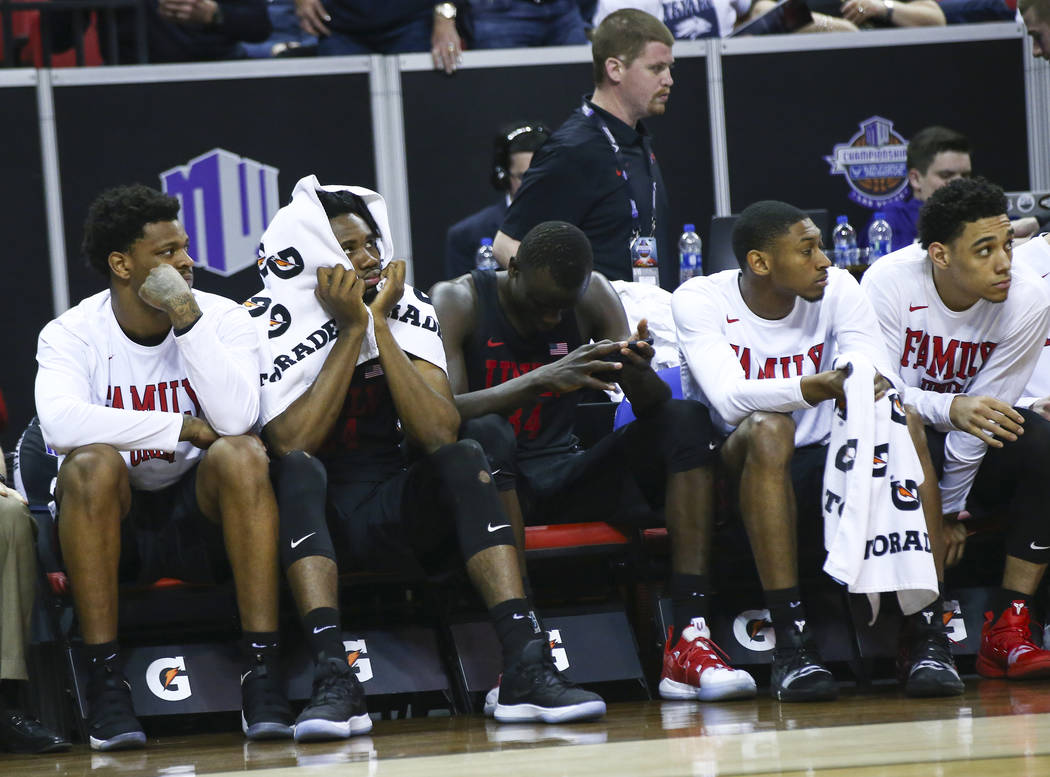 UNLV players on the bench react in the final moments of a quarterfinal game against San Diego State in the Mountain West men's basketball tournament at the Thomas & Mack Center in Las Vegas on ...