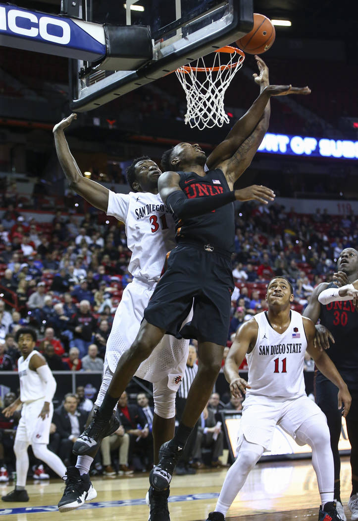 UNLV Rebels guard Kris Clyburn (1) goes to the basket against San Diego State Aztecs forward Nathan Mensah (31) during the second half of a quarterfinal game in the Mountain West men's basketball ...