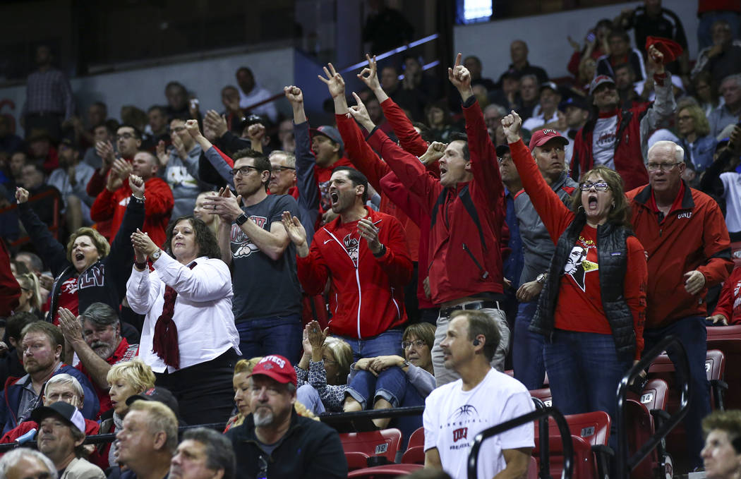 UNLV fans cheer during the second half of a quarterfinal game against San Diego State in the Mountain West men's basketball tournament at the Thomas & Mack Center in Las Vegas on Thursday, Mar ...