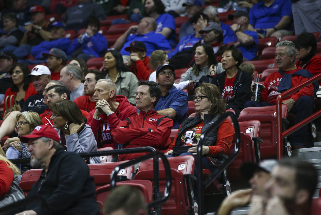 UNLV fans react during the second half of a quarterfinal game against San Diego State in the Mountain West men's basketball tournament at the Thomas & Mack Center in Las Vegas on Thursday, Mar ...