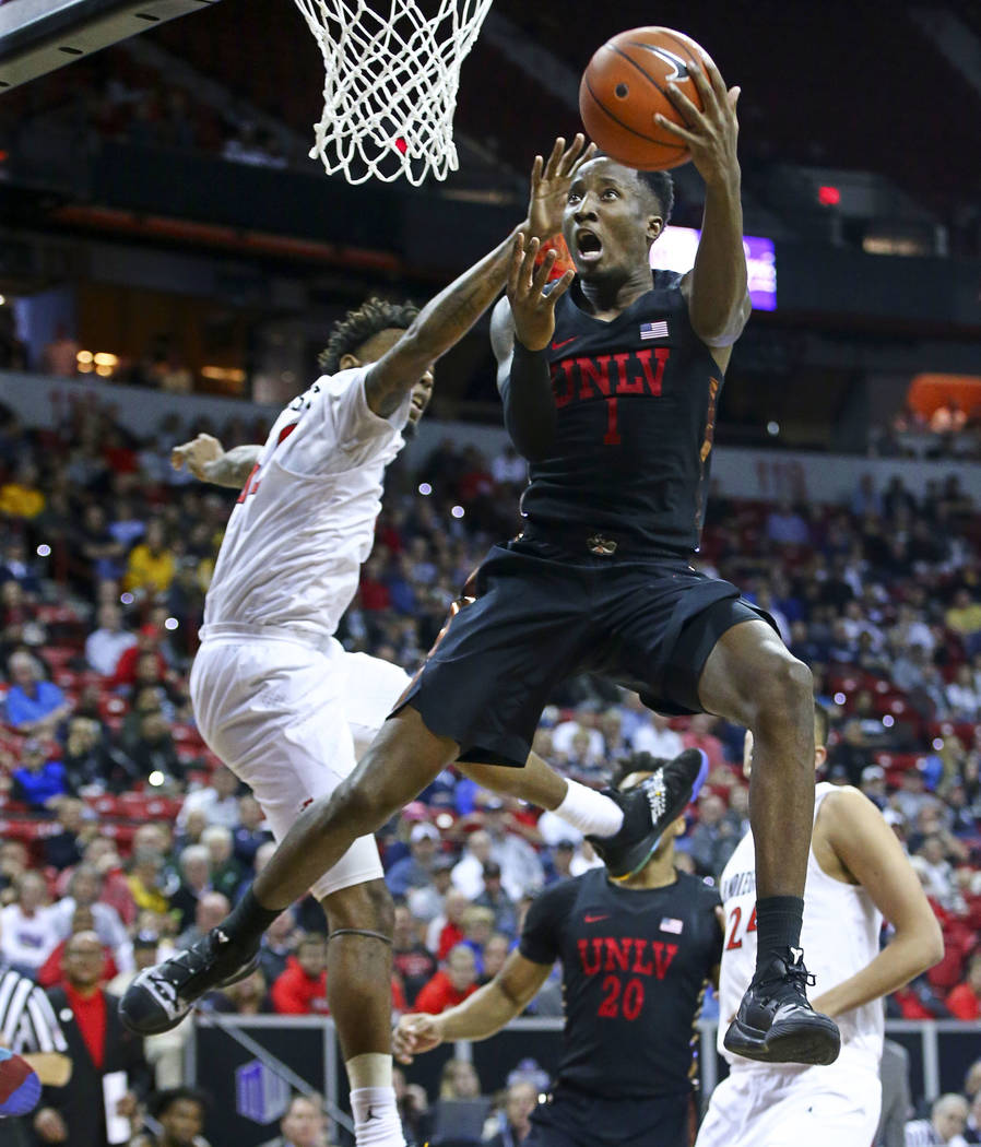 UNLV Rebels guard Kris Clyburn (1) goes to the basket against San Diego State Aztecs guard Jeremy Hemsley during the second half of a quarterfinal game in the Mountain West men's basketball tourna ...