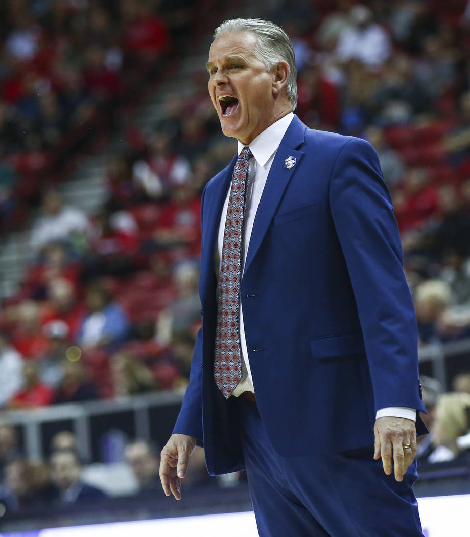 San Diego State Aztecs head coach Brian Dutcher reacts during the first half of a quarterfinal game against UNLV in the Mountain West men's basketball tournament at the Thomas & Mack Center in ...