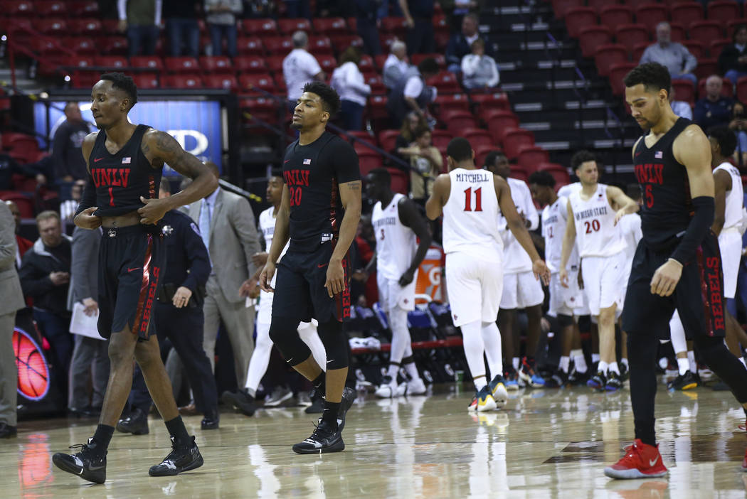 UNLV players walk off court after losing to San Diego State in a quarterfinal game at the Mountain West men's basketball tournament at the Thomas & Mack Center in Las Vegas on Thursday, March ...