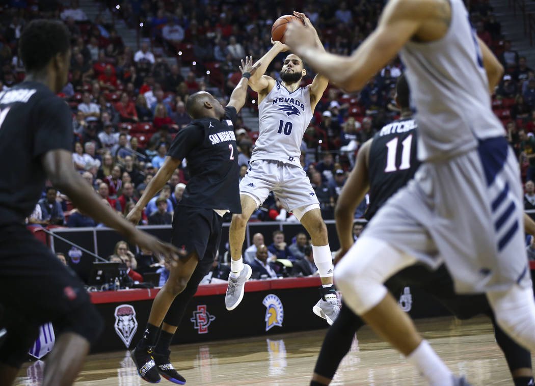 UNR Wolf Pack forward Caleb Martin (10) shoots over San Diego State Aztecs guard Adam Seiko (2) during the second half of a semifinal basketball game in the Mountain West men's basketball tourname ...