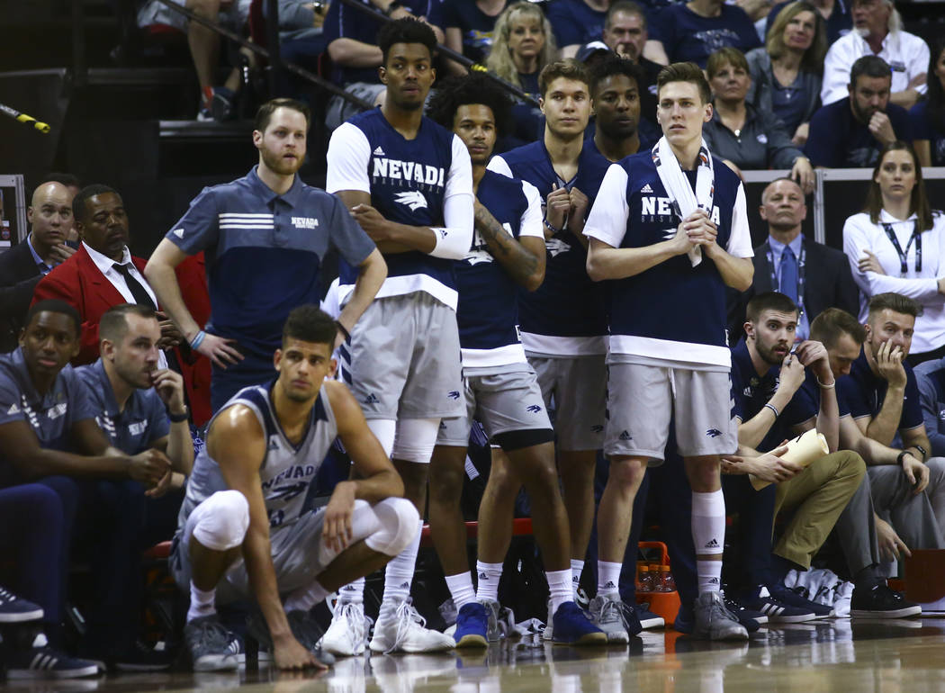 UNR players react as their team trails against San Diego State during the second half of a semifinal basketball game in the Mountain West men's basketball tournament at the Thomas & Mack Cente ...